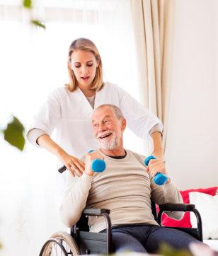 caregiver serving senior man on wheelchair