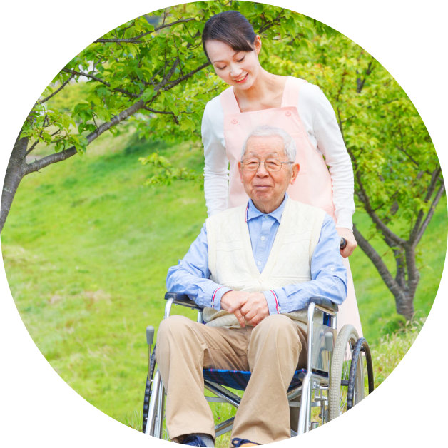 senior man on wheelchair with his caregiver