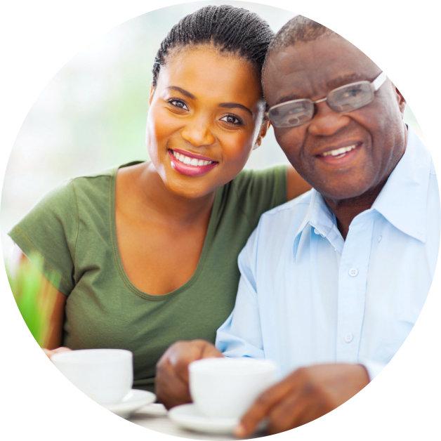 senior man and his daughter smiling